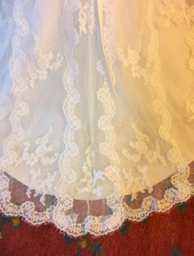 Couture jurk met prachtige sleep van Spaans kant